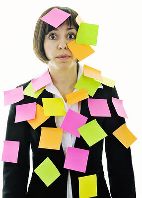 one frustrated young business woman with many of post representing concept memory and frustration on work